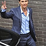 Matthew McConaughey flashed a peace sign in London.