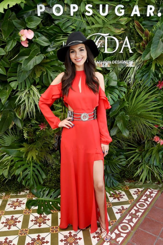 Victoria Justice wearing a cutout red maxi dress at the POPSUGAR x CFDA brunch.