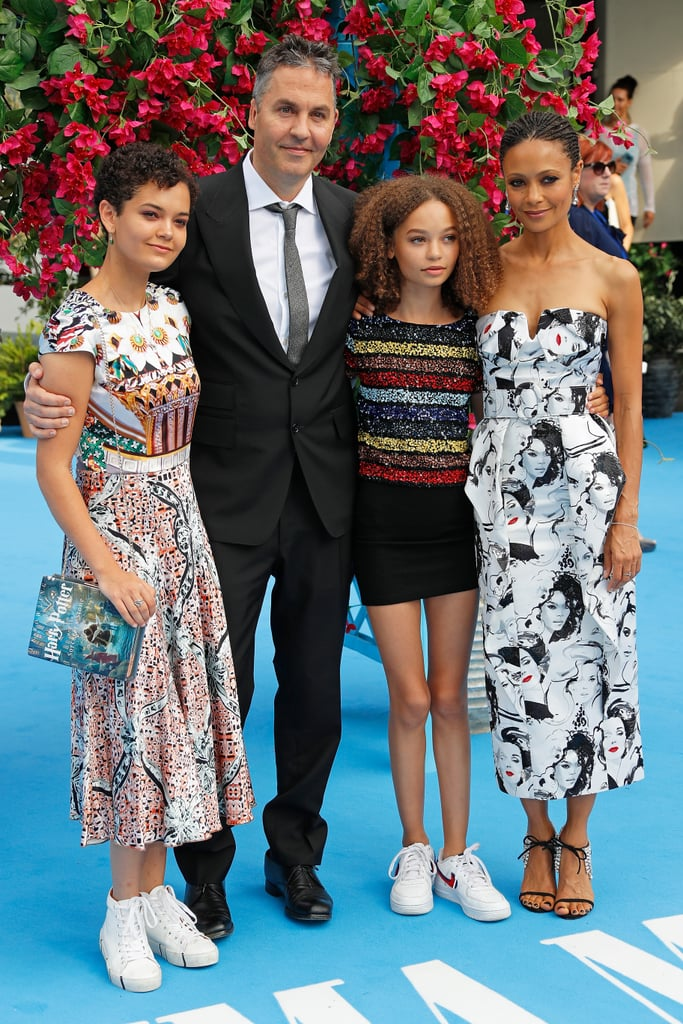 Thandie Newton was joined by her husband of nearly 20 years years, director Ol Parker, at the UK premiere of Mamma Mia! Here We Go Again in London on Monday. The stunning Westworld star also had two of her three children in tow: 17-year-old daughter Ripley, who carried a cool Harry Potter book clutch, and 13-year-old Nico, who is preparing to make her acting debut in Disney's live-action Dumbo movie next year (and is pretty much the spitting image of her famous mom).  Thandie posed with Ol — who wrote and directed the highly-anticipated Mamma Mia sequel — and their gorgeous girls on the red carpet ahead of the screening, which also brought out cast members Meryl Streep, Amanda Seyfried, Lily James, and Cher. Ol and Thandie have been married since 1998, and are also parents to 4-year-old son Booker. Keep reading to see their sweet family outing!