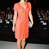 Molly Sims worked her curves in orange at the J. Mendel show.