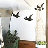 The Bird-Shaped Hooks on the Walls Are Both Functional and Cute