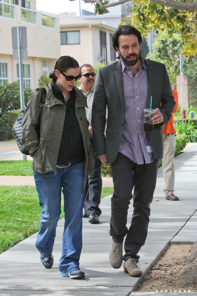 Jennifer Garner and Ben Affleck stayed close during a stroll in their LA neighborhood in March.