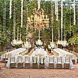 Overhead décor, like chandeliers and dangling orchids, make long reception tables look even more elegant.