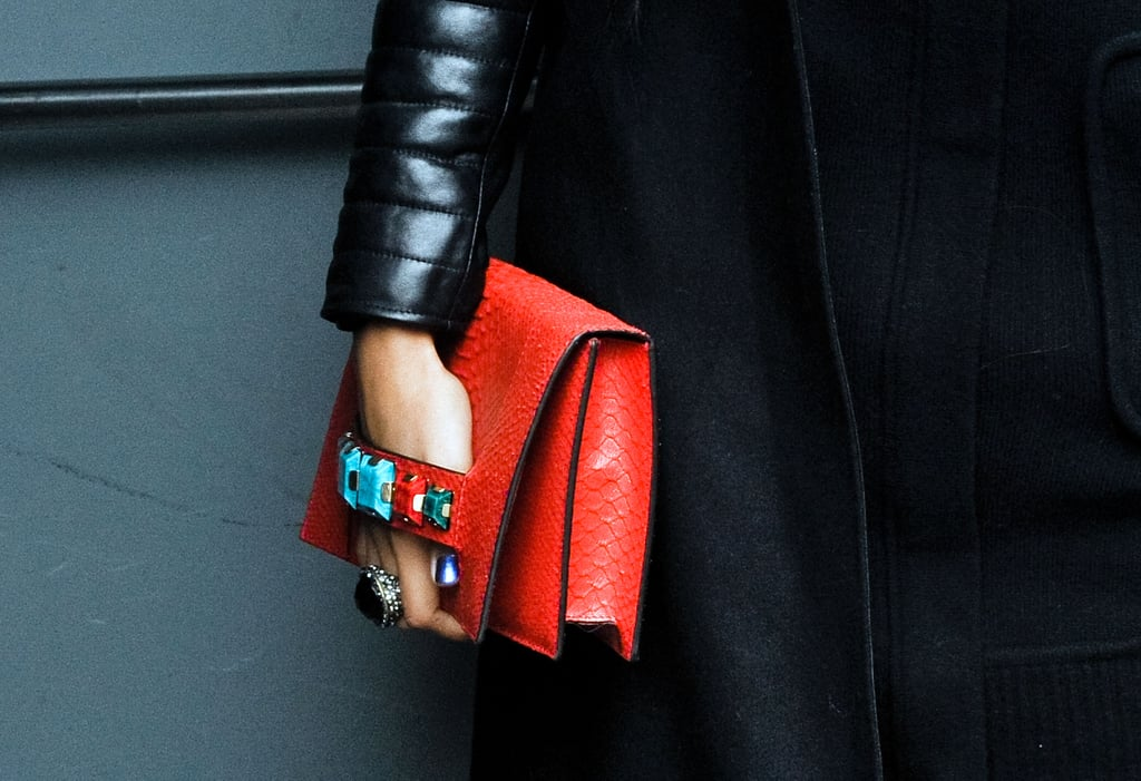 Multicolored stones added a tough touch to this red leather clutch.
