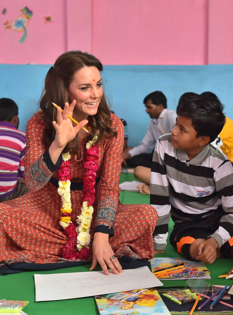 Kate Middleton has had a busy Tuesday in Mumbai, India, starting her day alongside Prince William visiting with underprivileged children in the major Indian city. Their morning engagement gave Kate another chance to hit a style high note, as she selected a floor-length dress from the UK brand Glamorous — it was the company's Red Navy Border Print Lace-Up Maxi Dress ($71). Her earrings were an equally budget-savvy choice from the UK high street brand Accessorize, its Filligree Bead Short Drop Earrings ($16).  What really made Kate's look stand out, though, wasn't the dress — it was the shoes. We've seen Kate in a variety of heels during her trip, from her beloved L.K.Bennett beige pumps to her favorite Mint Velvet wedge espadrilles. But on Tuesday, Kate threw us for a shoe loop by selecting a pair of flats. Hers came from the British brand Russell & Bromley, its Xpresso Flat ($250). It was Kate's first look of the day; she later changed into a jade Alice Temperley dress for a meeting with India's prime minister, Narendra Modi.