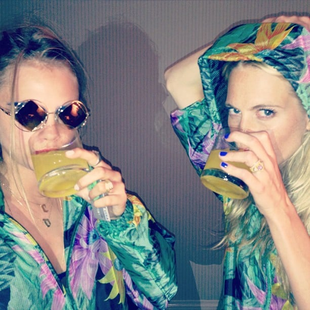 Cara and Poppy Delevingne enjoyed cocktails while wearing fun floral hoodies. Source: Instagram user poppydelevinge