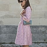 Hanneli Mustaparta showed her sweet side in a floral-adorned petal-pink babydoll dress and a Valentino bag at her side.