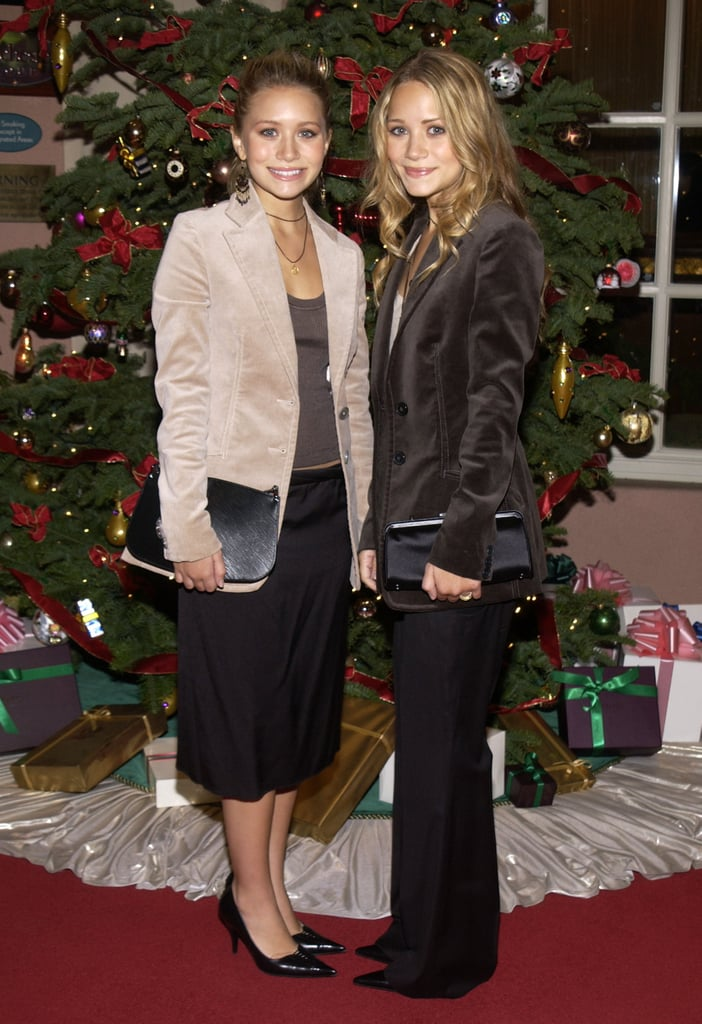 Twinning combo: The girls attended The Hollywood Reporter's annual party in velour blazers and office-ready separates.  Ashley struck a pose in a light velour blazer, loose black skirt, and patent pumps. Mary-Kate married black and brown in a textured topper, wide-leg trousers, and pointed pumps.