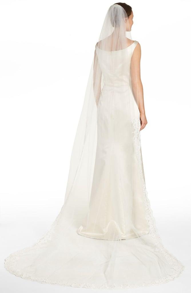Achieve that classic look with Brides & Hairpins' ethereal veil ($916) crafted of illusion tulle.