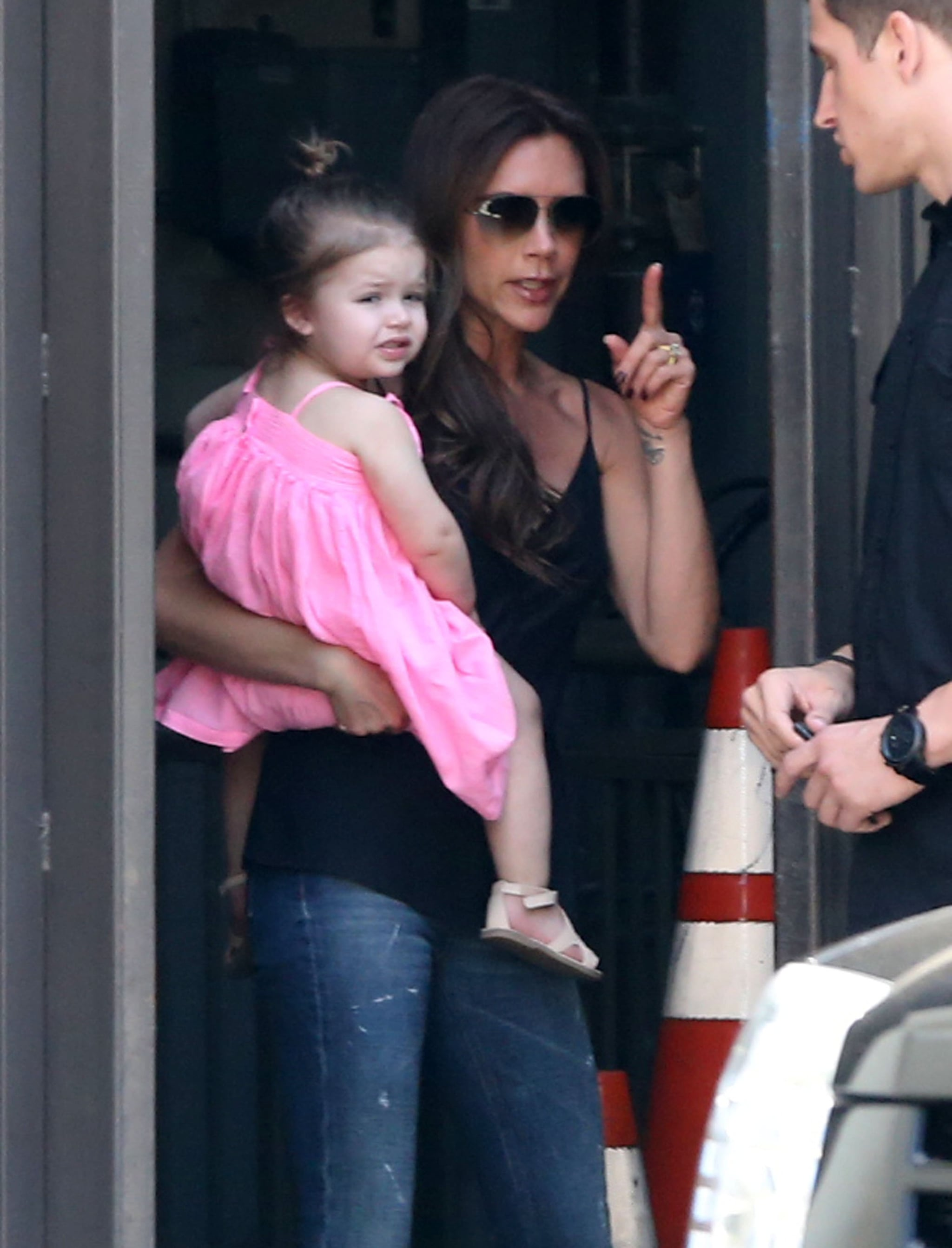 Victoria Beckham carried Harper through the outdoor mall in LA on Monday.