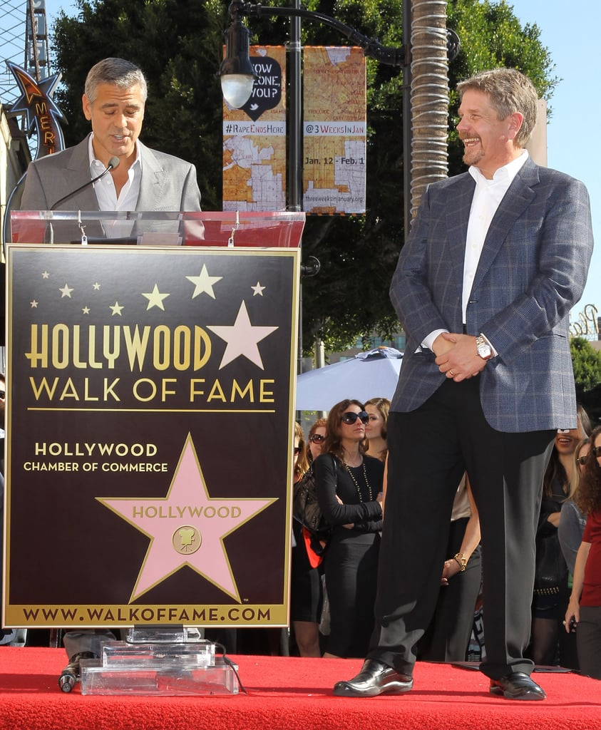 George Clooney honoring producer John Wells.