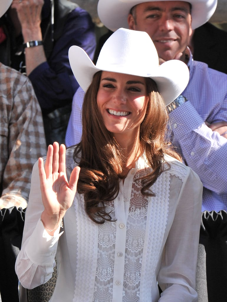 Proving that rodeo wares can be sweet too, Kate wore a lacy semisheer white Temperley London button-up with a white cowboy hat and dark-wash jeans for the Calgary Stampede Parade.