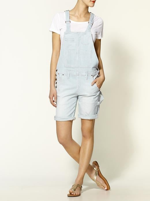 The slouchier fit and longer short length is a good bet for curvier shapes. We love the idea of styling this version up with lace-up flat sandals and a bright crossbody bag for weekend errands.  Sinclair Kingston Overalls ($279)