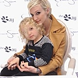 Ashlee Simpson snuggled with her young son, Bronx Wentz, while hosting a fashion event with sister Jessica Simpson in Toronto in December 2011.