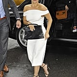Lady Gaga wearing a white off-the-shoulder Christian Siriano midi dress in NYC in December 2014.