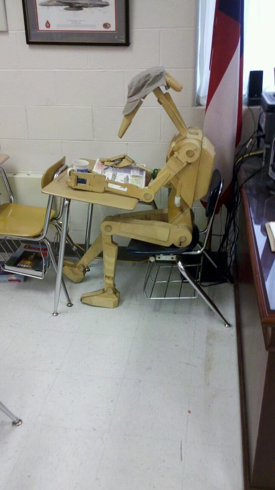 """I teach eighth grade and made this scale replica of a Star Wars droid. I dress and pose him depending on what time period we are discussing in class. His name is Roger-Roger. . . . Roger studying for class."" Source: Reddit user TheVishual via Imgur"