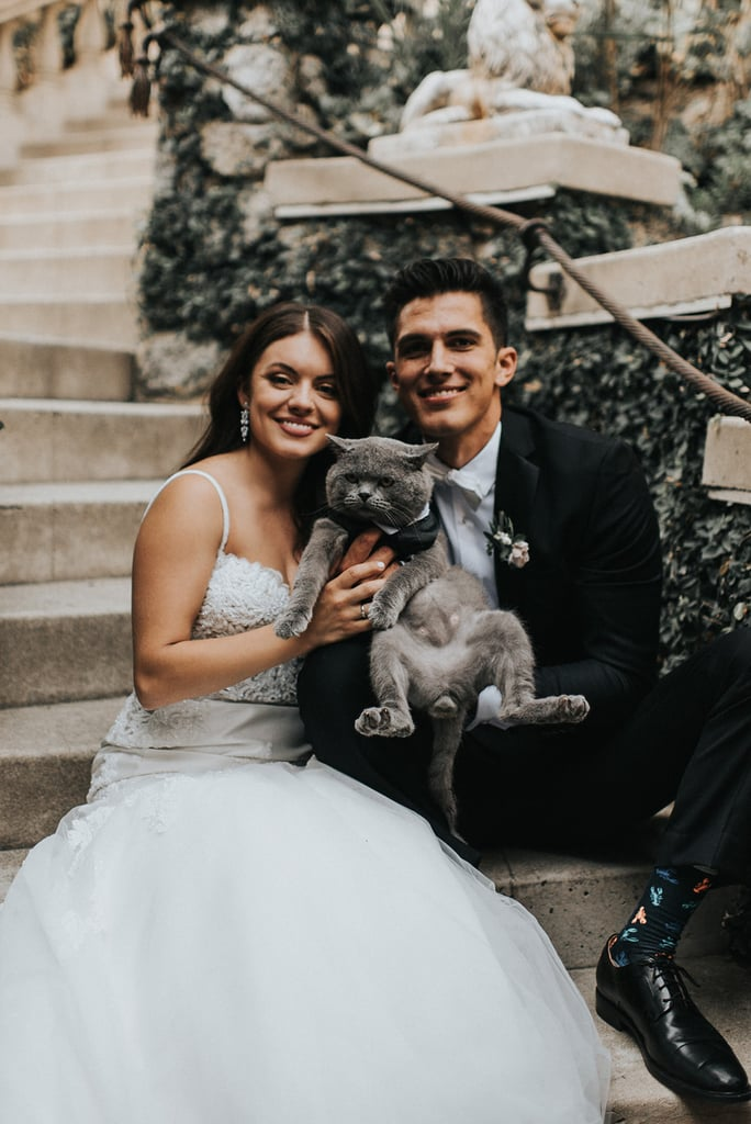 "As someone who is getting married in a few short weeks, I would love more than anything for my cats to be a part of my big day. However, based on the fact they're largely scared of their own shadows and scream at the top of their lungs when they go to the vet, this isn't possible. But for Michelle and Aaron Benitez, newlyweds and parents to their adorable cat Prince Michael, incorporating their fur baby into their wedding day was priority number one. So much so, that the pair actually made Prince Michael the best man, and Jonnie and Garrett — an Arizona-based couple who both happen to be photographers — captured every moment.  ""My husband adopted him, and we've had him for almost five years now,"" Michelle told POPSUGAR. ""Michael's a huge part of our lives and really important to us. It would have almost been weird not to have him part of our wedding day!"" ""He walked down the aisle with all the groomsmen and was dressed in his own suit."" Although some pets would be absolutely petrified to spend the day in front of dozens of wedding guests, Prince Michael is a completely different story. ""He's always been accustomed to being around a lot of people,"" explained Michelle, who noted that Aaron used to walk him on a leash in New York City. ""He does so well, he has the personality of a dog in many ways.""  Naturally, he was a hit among Michelle and Aaron's guests. ""Everyone who attended our wedding loved him,"" said Michelle. ""He walked down the aisle with all the groomsmen and was dressed in his own suit. They especially loved him during a few of our last dances. We brought him out and hoisted him in the air. People went wild!""  Read ahead to get an up-close-and-personal look at Michelle and Aaron's special day with Prince Michael by their side.       Related:                                                                                                           7 Surefire Signs You're a Card-Carrying Member of the Cat Lady Club"