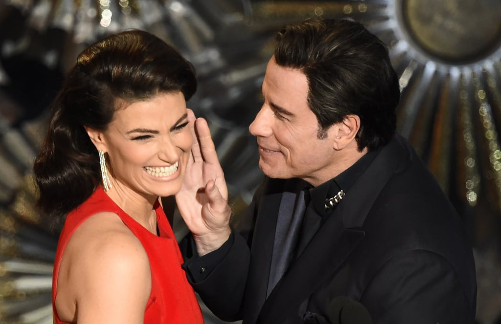 """Idina Menzel turned the tables on John Travolta during the Oscars on Sunday, introducing him as """"Glom Gazingo"""" in a clever nod to that time he called her """"Adele Dazeem"""" at last year's show. When John joined her on stage, he apologized for the infamous flub, and after Idina joked, """"It's not like it's going to follow me around for the rest of my life,"""" he said, """"Tell me about it."""" Keep reading to watch John Travolta redo his Idina introduction a year later, then see his confusing moment with Scarlett Johansson from earlier in the night."""
