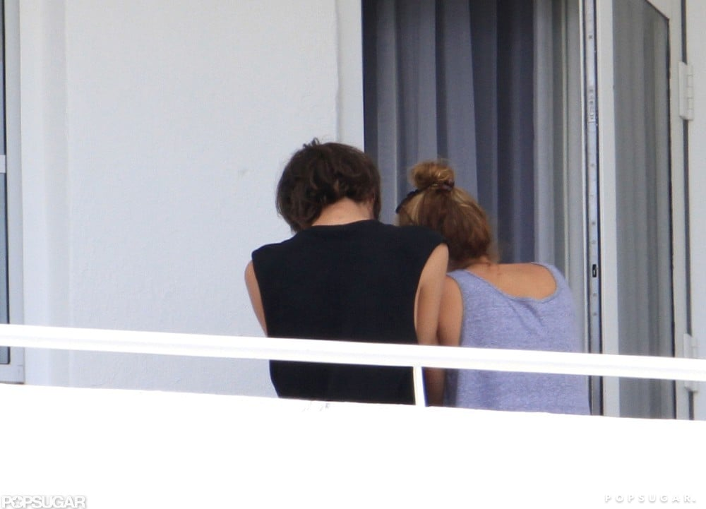 Miley Cyrus and her friend Cheyne Thomas hung out on the balcony of her Miami hotel room.