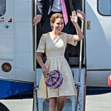 Kate Middleton in a chic yellow eyelet dress with Prince William during an arrival in Honiara, Solomon Islands, in September 2012.
