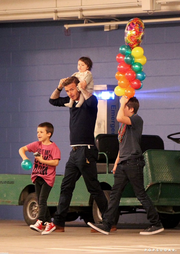 David Beckham, Brooklyn, Cruz, and Harper went to a February 2012 birthday party at a bowling alley in LA.