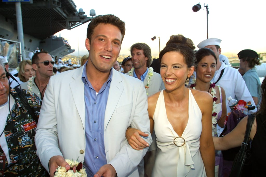Pearl Harbor might not go down in history as a classic film, but when it was released in 2001, it catapulted its female lead, Kate Beckinsale, into the big time. She'd already made a name for herself in period films and indie movies, but the big-budget blockbuster — in which she romanced both Ben Affleck and Josh Hartnett, be still our teenage hearts — made her a global star. And what we loved back then was something that's never really changed: Kate always looks like she's have serious fun! While her outfits may be a little more polished now than they were back then, she's barely changed, still sporting the same glossy brunette locks, golden tan, and megawatt smile. Take a nostalgic look back at the year that Kate became a megastar, then remind yourself of one of her more recent OMG red carpet moments.
