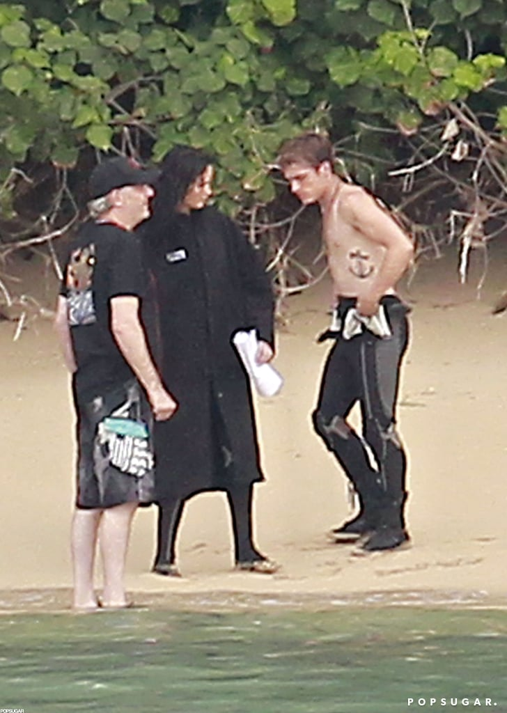 Jennifer Lawrence and Josh Hutcherson were back on the Hawaiian set of Catching Fire yesterday. Josh went shirtless, showing off a side tattoo while Jennifer wore a wet suit for filming. The costars first popped up in front of the cameras earlier this week after Jennifer enjoyed a few days off on the tropical island. Jennifer was in a bikini on the beach for Thanksgiving, which she celebrated with her brother. We may have to wait until next November to see her reprise her role as Katniss Everdeen on the big screen, but she'll be honored for her work before then. Jennifer will receive the outstanding performer of the year award at the Santa Barbara Film Festival in January following her success in The Hunger Games and Silver Linings Playbook this year.