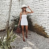 A Straw Hat and Printed Minidress