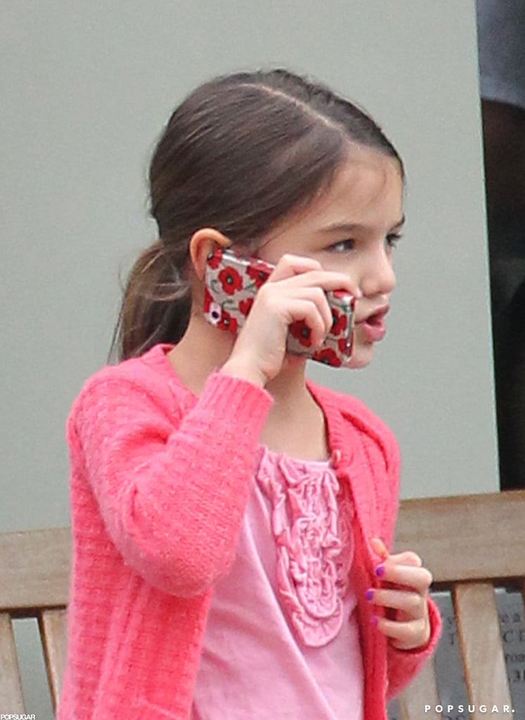 Suri Cruise chatted it up on an iPhone.