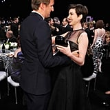Anne Hathaway hugged Tom Hooper.