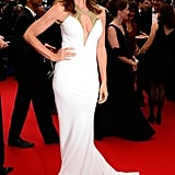 Cindy Crawford wore a stunning white Roberto Cavalli gown on Wednesday to the Opening Ceremony.