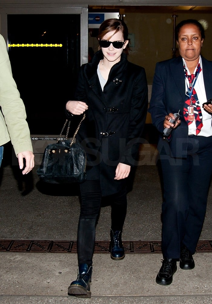 Emma Watson showed off her military coat and tough-girl boots on her way to LA.