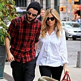 Tom Sturridge held Sienna Miller's hand as they arrived back at their NYC hotel.