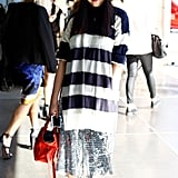 Susie Lau paired her stripes with a metallic skirt for a look that's high on texture and shine.