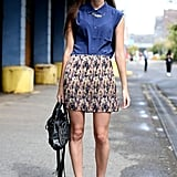 We love the schoolgirl-gone-edgy effect of adding statement shoes to a button-down and pleats.