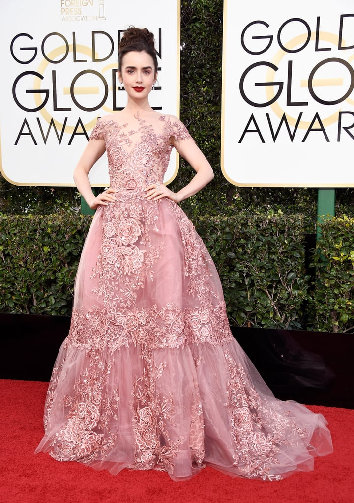 Lily Collins in a Zuhair Murad Couture, vintage Harry Winston diamonds, and Salvatore Ferragamo shoes in 2017.