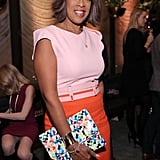 Gayle played up her look with a dainty chain, gold cuff, colorful clutch, and wide pink belt.