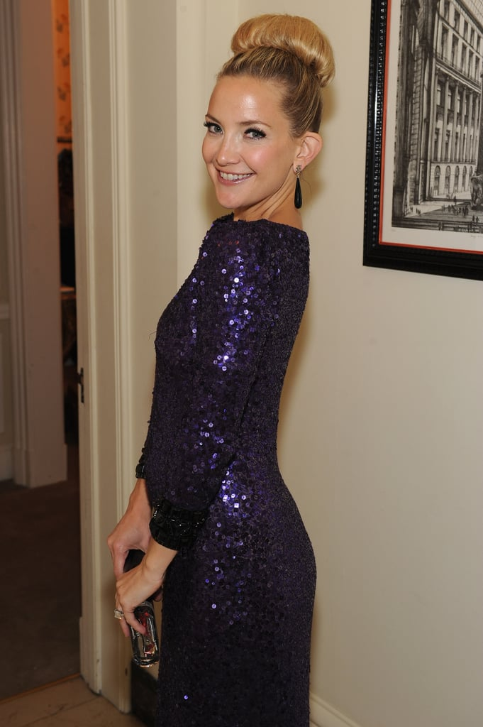 Kate Hudson wore her hair in a hight bun for the event.
