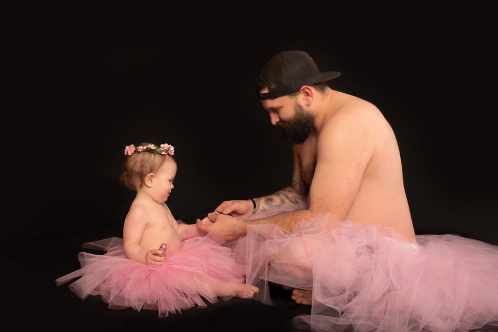 Dad and Baby Daughter Wear Matching Tutus For Photo Shoot