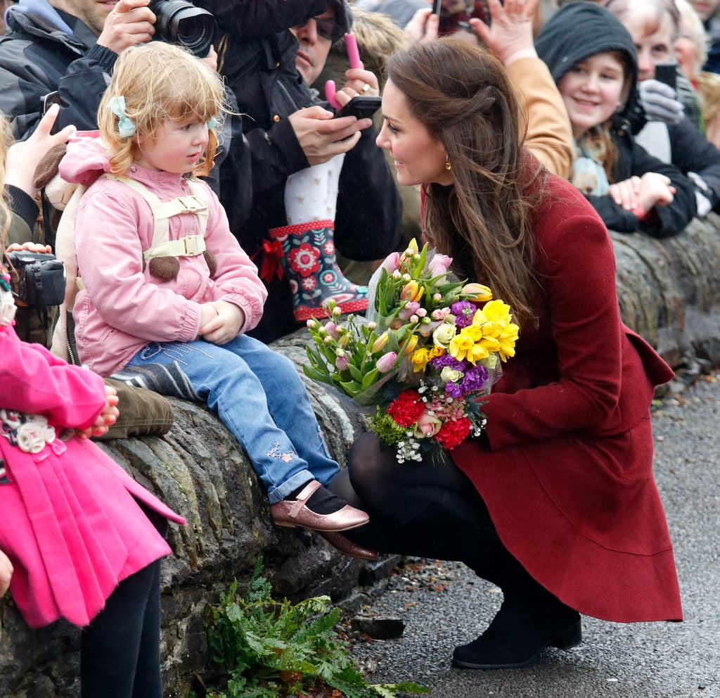 Kate knelt to chat with a young girl as she visited the Caerphilly Family Intervention Team in Wales in February 2017.