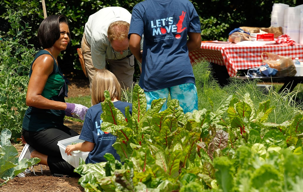 Michelle Obama, appearing to have a great time getting her hands dirty.