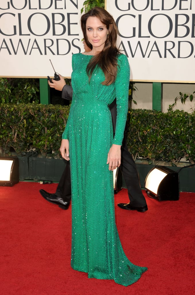 Angelina wore a long-sleeved light emerald green Atelier Versace gown covered entirely in Swarovski crystals and opened at the back to the 2011 Golden Globe Awards.