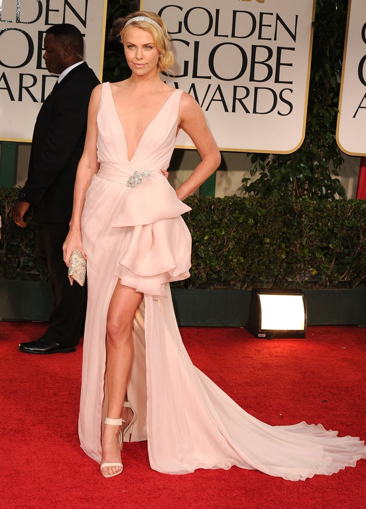 2193cd6408054 Charlize Theron lit up the Golden Globes red carpet in the most feminine