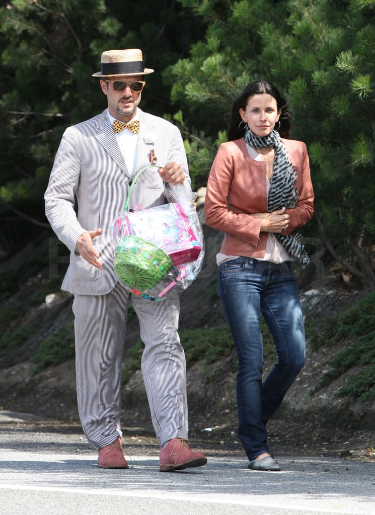 "David Arquette and Courteney Cox were armed with a gift basket when they arrived at a friend's house in Malibu yesterday. They were among the many celebrities who hopped around town on Easter to enjoy the Spring holiday with loved ones. Courteney and David are back to their own projects, Cougar Town and nightly showings at Beacher's Madhouse, respectively, since wrapping up their Scream 4 promotional tour. Their Sunday together seems to indicate they're still in the ""good place"" they settled into after announcing their separation late last year. David and Courteney are putting their differences aside for the sake of their young daughter, Coco, who recently had the treat of a family visit to Disneyworld."
