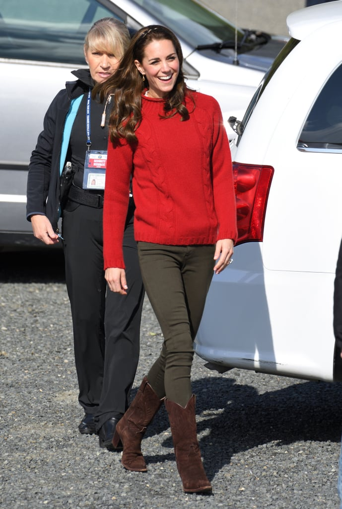 Later, Kate kept warm in a cozy knit from Really Wild.