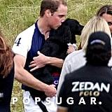 Prince William gave Lupo a kiss at a charity polo match.