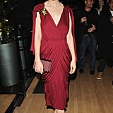 Draped in a rich burgundy Vionnet gown, paired with nude pointed pumps and a satin box clutch, Carey stunned at an afterparty in London.