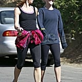 Reese Witherspoon goes for a walk with a friend in LA amidst pregnancy rumors.