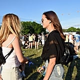 These friends coordinated with casual cutoffs and black leather backpacks that were practical yet chic.