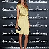 Astrid Munoz chose a silky topaz-colored cocktail dress and gold strappy heels for her appearance at the Jaeger-LeCoultre party.